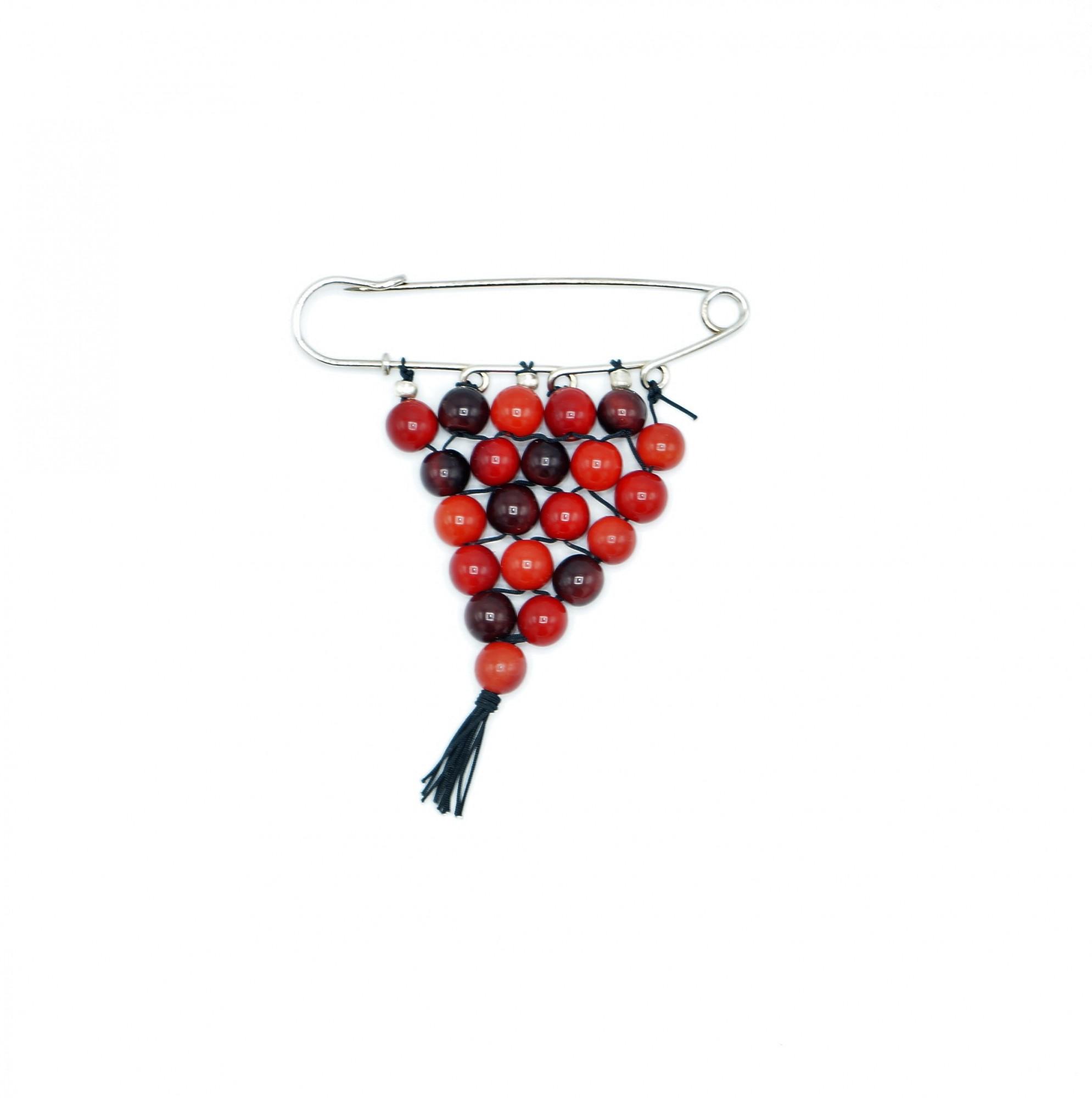 Broche façon épingle à nourrice en perle d\'ivoire végétal rouge Nodova