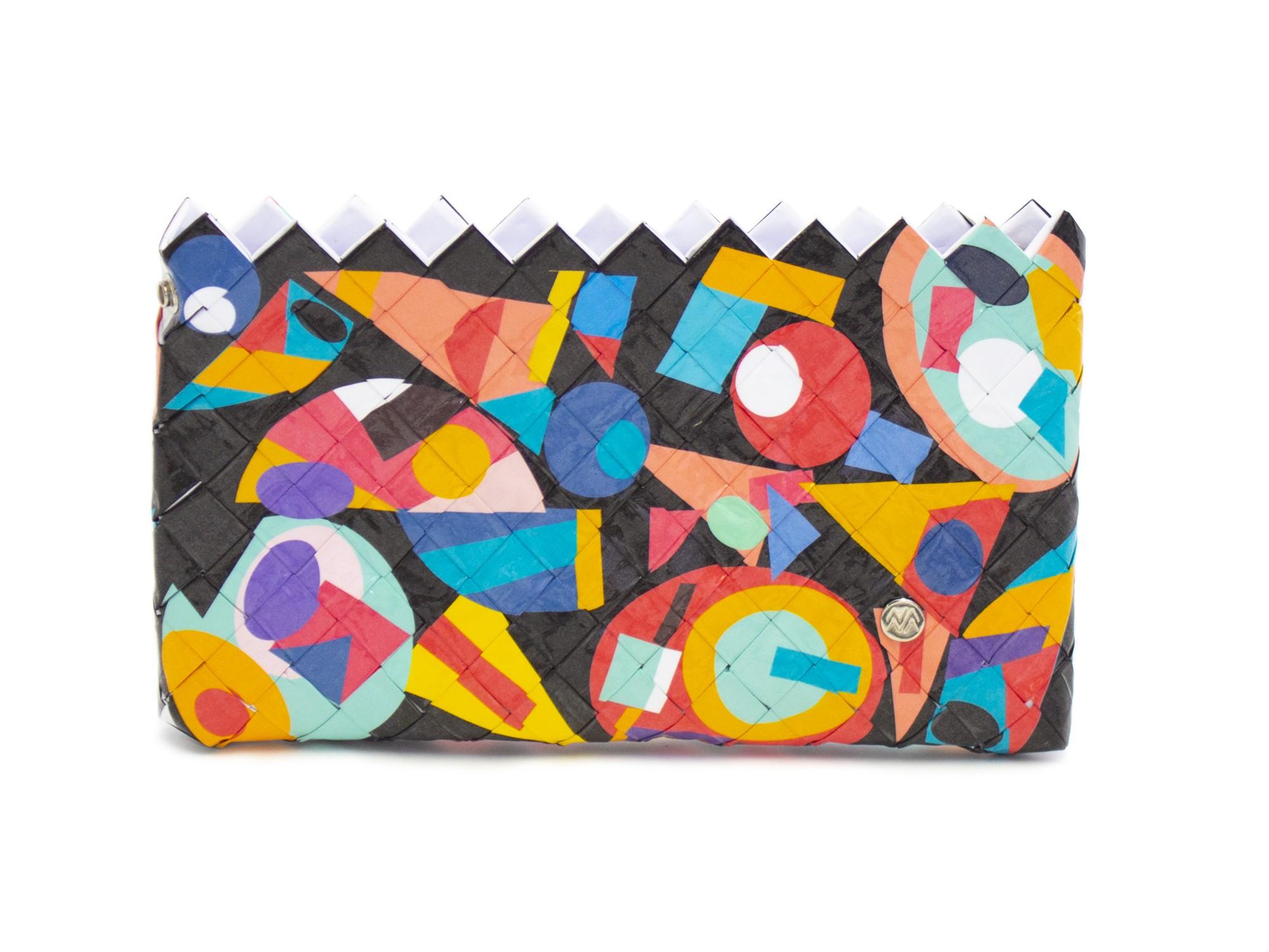 Sac à main / Pochette à fond noir Puzzle Naona